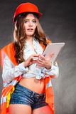 Woman structural engineer with tablet working. Stock Photo