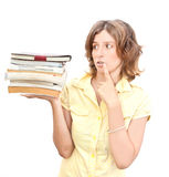 Woman with stuck of books over white Royalty Free Stock Image