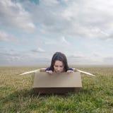 Woman stuck in box Stock Image