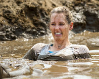 Woman stuck in the mud with a smile Stock Photography