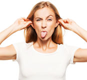 Woman stuck out her tongue Stock Photography