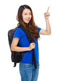 Woman student with backpack and finger up Royalty Free Stock Image
