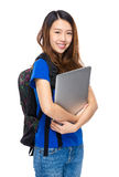 Woman student with backpack and laptop Stock Photos