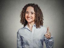 Woman student being excited giving showing thumbs up hand gesture Stock Photography