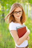 Woman-student with books in hands Royalty Free Stock Photography