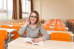 Woman Student With Books Sitting In Classroom Stock Image