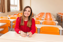 Woman Student With Books Sitting In Classroom Royalty Free Stock Images