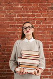 Woman student with bunch of books, free space Stock Photography