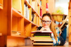 Woman student in college library Stock Photos