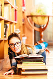 Woman student in college library Royalty Free Stock Image