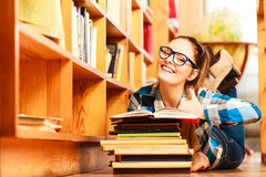 Woman student in college library Royalty Free Stock Photo