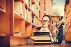 Woman student in college library Royalty Free Stock Images