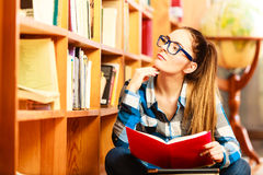 Woman student in college library Royalty Free Stock Photos