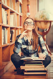 Woman student in college library Stock Photo