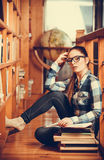 Woman student in college library Stock Image