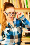 Woman student in college library Royalty Free Stock Photography
