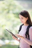 Woman student with digital tablet Royalty Free Stock Image