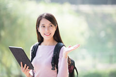 Woman student with digital tablet Royalty Free Stock Photography