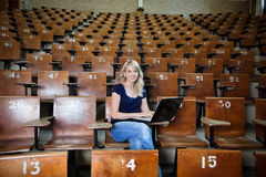 Woman Student in Empty Lecture Hall Stock Photo