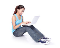 Woman student happy sitting with laptop Stock Photo