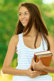 Woman-student holding books Stock Images