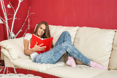Woman student learns at home on the sofa Royalty Free Stock Photo