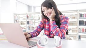 Woman student in the library Royalty Free Stock Image