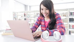 Woman student in the library Stock Image
