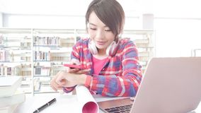 Woman student in the libray Royalty Free Stock Images