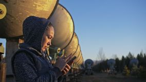 Woman student operator of institute of Solar Terrestrial Physics monitors communication equipment in mobile. Unique. Woman student operator of institute of Solar stock footage