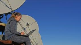 Woman student operator of institute of Solar Terrestrial Physics monitors communication equipment in notebook. Unique. Array solar radio telescope. Sun Solar stock video footage