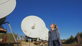 Woman student operator of institute of solar terrestrial physics monitors communication equipment in notebook. Unique. Array solar radio telescope. Sun Solar stock video