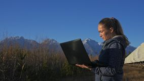 Woman student operator of institute of Solar Terrestrial Physics monitors communication equipment in notebook. Unique. Array solar radio telescope. Sun Solar stock footage