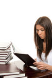 Woman student reading and studying book Royalty Free Stock Images