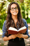 Woman-student reads textbook Stock Image