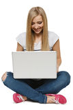 Woman student sitting with laptop. Isolated on white background Stock Photos