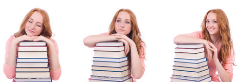 The woman student with stacks of books Stock Images