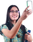 Woman student taking picture with her handphone. Isolated on white background Stock Photos