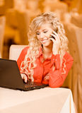 Woman-student works on black laptop royalty free stock photography