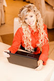 Woman-student works on black laptop Royalty Free Stock Images