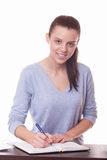 Woman student write in notebook Royalty Free Stock Photos