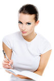 Woman-student writes in exercise Stock Photos