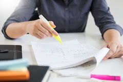 Woman student writing in diary or reading artistic literature do. Woman student  writing in diary or reading artistic literature doing homework at home preparing Stock Images