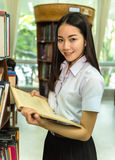 Woman students are a handful of books stock photography