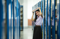 Woman students are a handful of books stock image