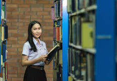 Woman students are a handful of books royalty free stock images
