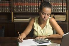 Woman Studies in Library - Horizontal stock image