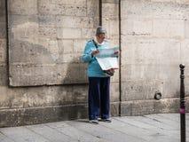 Woman studies map near ancient Paris wall Royalty Free Stock Photos