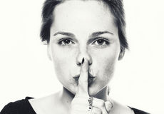 Woman studio face black and white healthy skin with finger on lips Silence Stock Photo