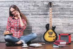 Woman in studio with guitar Stock Image
